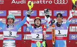 (L to R) Second placed Felix Neureuther of Germany, first placed Marcel Hirscher of Austria and third placed Mario Matt of Austria celebrate on the podium after the men's Slalom race at the World Alpine Skiing Championships in Schladming February 17, 2013. REUTERS/Dominic Ebenbichler