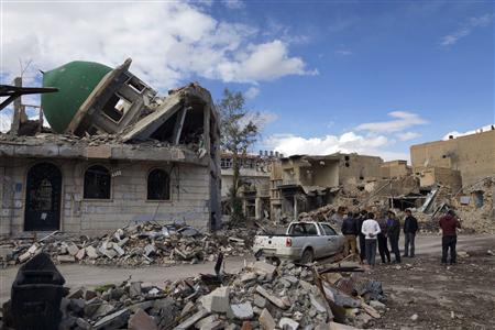 A group of Syrian Free Army activists inspect a damaged mosque at the Sheikh Yassine district area in the eastern city of Deir al-Zor February 16, 2013. REUTERS/ Khalil Ashawi