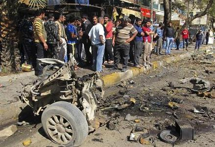 Residents gather at the site of a car bomb attack in the Karrakda district in Baghdad February 17, 2013. A series of car bombs exploded in mainly Shi'ite neighbourhoods across the Iraqi capital Baghdad on Sunday, killing at least 20 people and wounding dozens, police and hospital sources said. REUTERS/Ahmed Malik