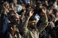 Shi'ite Muslims gather to protest against Saturday's bomb attack in Quetta's Shi'ite Muslim area, in Lahore February 17, 2013. A provincial official criticized Pakistani security forces on Sunday after a bombing targeting the Shi'ite Hazara community killed 80 people in the northwestern city of Quetta. REUTERS/Mohsin Raza (PAKISTAN - Tags: CIVIL UNREST CRIME LAW POLITICS RELIGION)