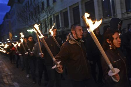 Members of various nationalist organizations march with torches in memory of former general Hristo Lukov in downtown Sofia February 16, 2013. Lukov was an army commander in World War I and led the former far-right organisation, the Union of Bulgarian National Legions. He died on February 13, 1943. REUTERS/Tsvetelina Belutova