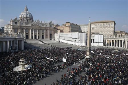 People are gathered in St Peter's square as Pope Benedict XVI leads his Sunday Angelus prayer at the Vatican February 17, 2013. REUTERS/Tony Gentile