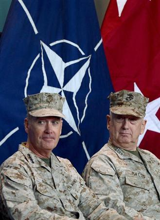 U.S. Marine General Joseph Dunford (L) attends a change of command ceremony at the ISAF headquarters in Kabul February 10, 2013. REUTERS/Massoud Hossaini/Pool (AFGHANISTAN - Tags: MILITARY POLITICS)