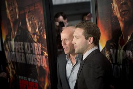 Cast members Jai Courtney (R) and Bruce Willis meet with fans to celebrate the opening of their new film ''A Good Day To Die Hard'' in New York February 13, 2013. REUTERS/Andrew Kelly