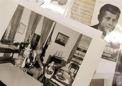 A photo of former U.S. President with his children John Jr. and Caroline in costumes taken on October 31, 1963 is displayed among other items as part of the McInnis Auctioneers Presidential Auction in Amesbury, Massachusetts February 10, 2013. REUTERS/Jessica Rinaldi
