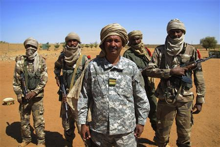 Malian Colonel El Hadj Ag Gamou poses for a picture with soldiers under his command in Gao, Mali February 15, 2013. REUTERS/David Lewis