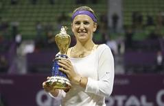 Victoria Azarenka of Belarus holds her trophy after defeating Serena Williams of the U.S. during the final match at the Qatar Open tennis tournament in Doha February 17, 2013. REUTERS/Fadi Al-Assaad