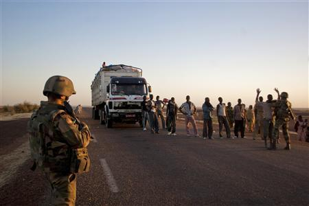 French soldiers search people at a checkpoint on the outskirts of Gao, Mali February 14, 2013. REUTERS/Francois Rihouay