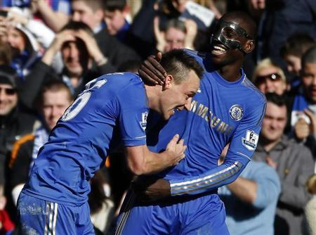 Chelsea's John Terry (L) celebrates his goal against Brentford with Demba Ba during their FA Cup fourth round replay soccer match at Stamford Bridge in London February 17, 2013. REUTERS/Eddie Keogh
