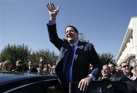 Cyprus presidential candidate Nicos Anastasiades of the right wing Democratic Rally party waves to supporters outside a polling station in Limassol February 17, 2013. REUTERS/Yorgos Karahalis