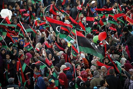 People wave Libyan flags during celebrations commemorating the second anniversary of the country's February 17 revolution, at Martyrs' Square in Tripoli February 17, 2013. REUTERS/Ismail Zitouny