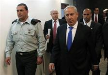 Israel's Prime Minister Benjamin Netanyahu (R) arrives at the weekly cabinet meeting in Jerusalem February 17, 2013. Netanyahu appealed on Sunday for Israel's secret services to be spared public scrutiny, in an apparent bid to douse speculation that an Australian immigrant's 2010 jailhouse suicide was espionage-related and covered up. REUTERS/Ronen Zvulun