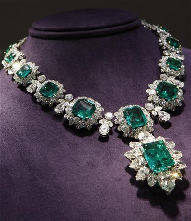 An emerald and diamond pendant and necklace by Bvlgari priced between $2.5 million to $3.5 million, which was a gift from Richard Burton to Elizabeth Taylor, is seen on display as part of the upcoming auction of Taylor's jewelry, clothing, art and memorabilia at Christie's Auction house in New York City, December 1, 2011. REUTERS/Mike Segar