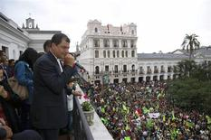 Ecuador's President Rafael Correa addresses his supporters from a balcony of Carondelet Palace in Quito February 17, 2013. REUTERS/Gary Granja