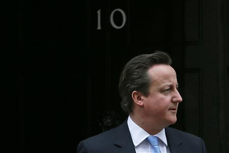 Britain's Prime Minister David Cameron waits to greet Nigeria's President Goodluck Jonathan at Number 10 Downing Street in London February 11, 2013. REUTERS/Stefan Wermuth