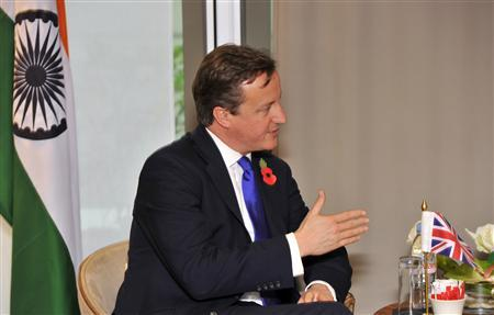 Britain's Prime Minister David Cameron talks to India's Prime Minister Manmohan Singh at the start of a bilateral meeting before the start of the G20 Summit of major world economies in Cannes November 3, 2011. REUTERS/Toby Melville