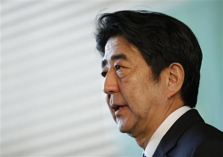 Japan's Prime Minister Shinzo Abe speaks to media after attending a meeting of Security Council of Japan at his official residence in Tokyo February 12, 2013 after reports of North Korea's possible nuclear test. REUTERS/Issei Kato