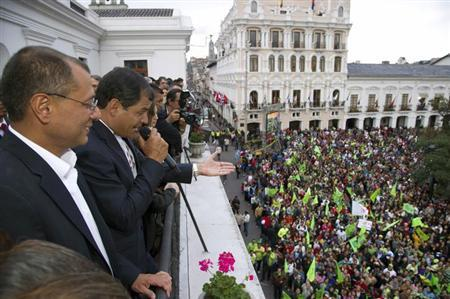 Ecuador's President Rafael Correa (2nd L) joined by his vice president Jorge Glass addresses his supporters from a balcony of Carondelet Palace in Quito February 17, 2013. REUTERS/Gary Granja