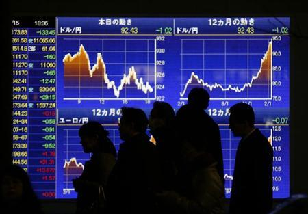 People walk past an electronic board showing the graphs of exchange rates between the Japanese yen and the U.S. dollar outside a brokerage in Tokyo February 15, 2013. REUTERS/Toru Hanai