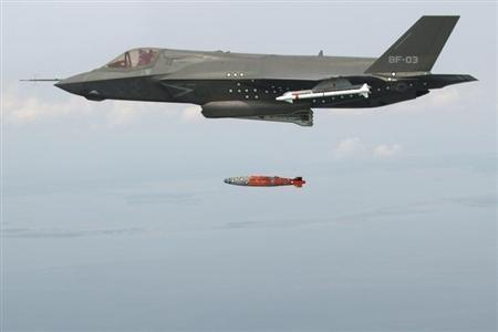 BF-3, a short take-off and vertical landing F-35 Lightning II, releases an inert 1,000 lb. GBU-32 Joint Direct Attack Munition (JDAM) separation weapon over water in an Atlantic test range in Patuxent River, Maryland August 8, 2012.REUTERS/Andy Wolfe/Lockheed Martin/Handout/Files