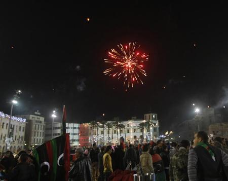 Fireworks explode in the sky during celebrations commemorating the second anniversary of the country's February 17 revolution, at Martyrs' Square in Tripoli February 17, 2013. REUTERS/Ismail Zitouny