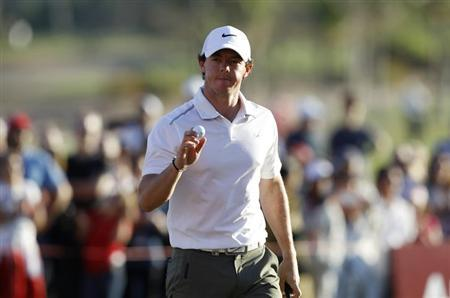 Rory McIlroy of Northern Ireland leaves the 18th green at the end of his match during the second round of the Abu Dhabi Golf Championship at the Abu Dhabi Golf Club January 18, 2013. REUTERS/Ahmed Jadallah