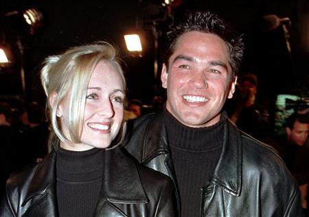 Actor Dean Cain escorts his girlfriend, country music singer Mindy McCready, to the premiere of the new horror film ''Scream 2'' at Mann's Chinese Theatre in Hollywood, California in this December 10, 1997 file photograph. McCready has died aged 37 from an apparently self-inflicted gunshot wound, an Arkansas sheriff said on February 17, 2013. REUTERS/Fred Prouser/Files