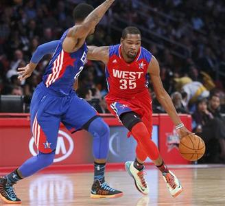 NBA All-Star Kevin Durant of the Oklahoma Thunder (35) drives the ball past All-Star Paul George of the Indianapolis Pacers during the NBA All-Star basketball game in Houston, Texas, February 17, 2013. REUTERS/Lucy Nicholson