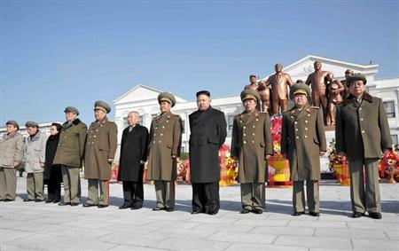 North Korean leader Kim Jong-Un (4th R) and officials attend a wreath laying ceremony in front of a statue of North's founder Kim Il-Sung and his son and late leader Kim Jong-Il at the Mangyongdae Revolutionary School in Pyongyang on the occasion of birth anniversary of the late leader Kim Jong-Il, which falls on Saturday, in this undated recent picture released by the North's official KCNA news agency on February 16, 2013. REUTERS/KCNA
