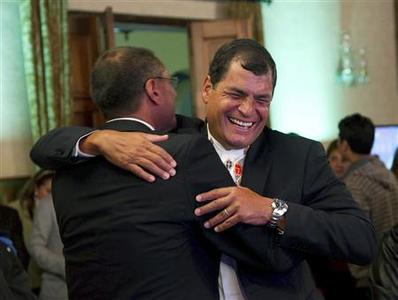 Ecuador's President Rafael Correa celebrates with his Vice President-elect Jorge Glass after hearing results at Carondelet Palace in Quito February 17, 2013. Correa claimed victory in Sunday's presidential election, giving him a new four-year term to continue his socialist revolution and strengthen Latin America's alliance of leftist leaders. REUTERS/Gary Granja