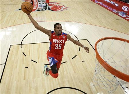 NBA All-Star Kevin Durant of the Oklahoma Thunder goes in all alone for a dunk during the 2013 NBA All-Star basketball game in Houston, Texas, February 17, 2013. REUTERS/Eric Gay