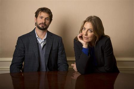 Screenwriter Mark Boal and Director Kathryn Bigelow pose for photos for their new film 'Zero Dark Thirty' in New York December 4, 2012. REUTERS/Andrew Kelly/Files
