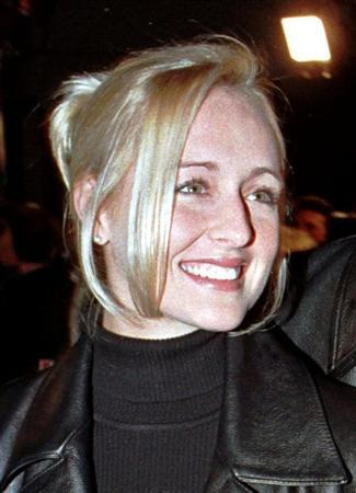 Country music singer Mindy McCready attends the premiere of the horror film ''Scream 2'' at Mann's Chinese Theatre in Hollywood in this December 10, 1997 file photograph. REUTERS/Fred Prouser/Files