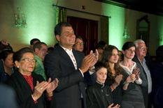(L-R) Carmen Delgado, mother of Ecuador's President Rafael Correa; Correa, his son Miguel Correa Malherb, his daughter Dominique Correa Malherb and his wife Anne Malherbe, react after hearing the elections results at Carondelet Palace in Quito February 17, 2013. REUTERS/Gary Granja