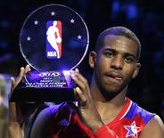 NBA All-Star Chris Paul of the Los Angeles Clippers holds up the MVP trophy after the 2013 NBA All-Star basketball game in Houston, Texas, February 17, 2013. REUTERS/Lucy Nicholson