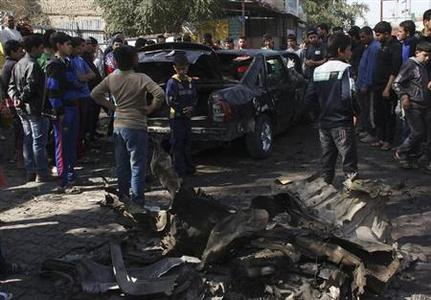 Residents gather at the site of a car bomb explosion in Sadr City, northeastern Baghdad February 17, 2013. A series of car bombs exploded in mainly Shi'ite neighbourhoods across the Iraqi capital Baghdad on Sunday, killing at least 20 people and wounding dozens, police and hospital sources said. REUTERS/Wissm al-Okili