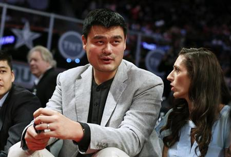 Former NBA player Yao Ming looks on during the NBA basketball All-Star weekend in Houston, Texas, February 16, 2013. REUTERS/Lucy Nicholson