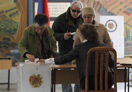People visit a polling station during the presidential election in Yerevan, February 18, 2013. REUTERS/David Mdzinarishvili