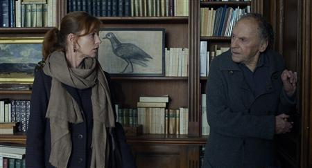 Actors Isabelle Huppert (L) and Jean-Louis Trintignant are shown in a scene from the Austrian film ''Amour'' in this publicity photo released to Reuters January 10, 2013. The film has been nominated for best foreign language film, as well as best picture for the 85th Academy Awards Thursday. The Oscars will be presented in Hollywood, California February 24, 2013. REUTERS/Darius Khondji/ Films du Losange/Sony Pictures Classics/Handout