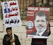 Muslim Brotherhood members and supporters of Egyptian President Mohamed Mursi chant pro-Mursi slogans, during a rally in front of the Sultan Hassan and Refaie mosques in the old town of Cairo November 30, 2012. REUTERS/Amr Abdallah Dalsh