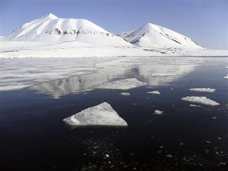 Snow-covered mountains look over the Isfjord in Svalbard, June 1, 2012. REUTERS/Balazs Koranyi