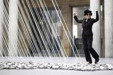 "Japanese artist Yoko Ono dances next to art pieces ""river bed and morning beams"" during the opening of the exhibition ""Half-a-wind show. A retrospective"" at Schirn Kunsthalle in Frankfurt February 14, 2013. REUTERS/Lisi Niesner"