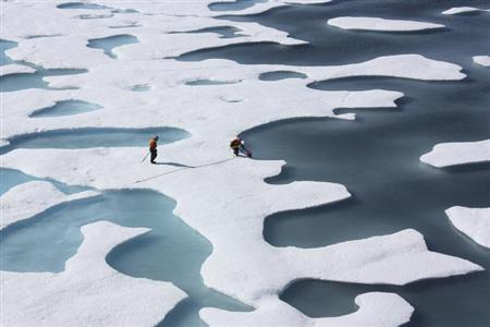 The crew of the U.S. Coast Guard Cutter Healy, in the midst of their ICESCAPE mission, retrieves supplies for some mid-mission fixes dropped by parachute from a C-130 in the Arctic Ocean in this July 12, 2011 NASA handout photo obtained by Reuters June 11, 2011. REUTERS/Kathryn Hansen/NASA