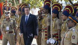 Britain's Prime Minister David Cameron arrives to pay tributes at a memorial dedicated to policemen who lost their lives in November 2008 attacks, in Mumbai February 18, 2013. Cameron arrived in India on Monday as a graft scandal engulfed an Anglo-Italian helicopter deal and immediately told his hosts they should open up their economy because Britain has done the same for Indian firms. REUTERS/Stringer