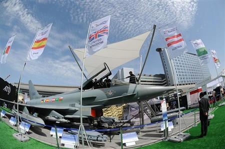 People look at an Eurofighter Typhoon aircraft on display during the International Defence Exhibition and Conference (IDEX) at the Abu Dhabi National Exhibition Centre February 17, 2013. REUTERS/Ben Job