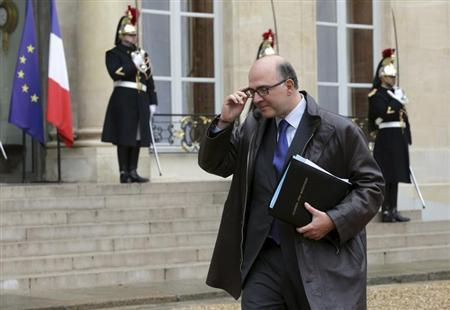 French Economy and Finance Minister Pierre Moscovici leaves the Elysee Palace following the first weekly cabinet meeting of the year in Paris January 3, 2013. REUTERS/Philippe Wojazer