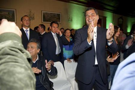 Ecuador's President Rafael Correa (R) reacts after hearing election results at Carondelet Palace in Quito February 17, 2013. REUTERS/Gary Granja