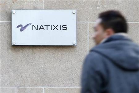 A man walks past the logo of French bank Natixis at one of their offices in Paris February 18, 2013. French bank Natixis said on Sunday it would simplify its finances by shedding a 20 percent stake in BPCE, a network of cooperative lenders which controls it, paving the way for higher dividends in the future. Natixis said it would sell 12 billion euros ($16.02 billion) in investment certificates through which it owned a fifth of parent company BPCE to BPCE and its cooperative shareholders. REUTERS/Charles Platiau