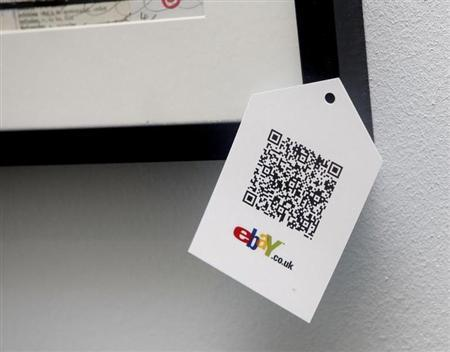 A QR code is seen on goods for sale during the launch of a temporary ''pop-up'' Christmas shop run by online giant eBay on Dean Street in Soho, central London November 29, 2011. REUTERS/Neil Hall