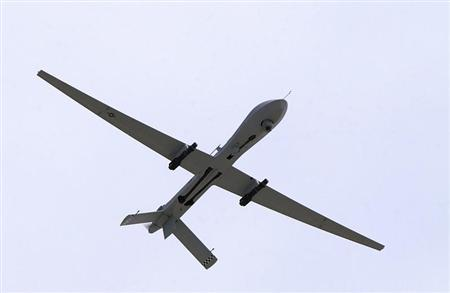 A U.S. Air Force MQ-1 Predator, unmanned aerial vehicle, armed with AGM-114 Hellfire missiles, performs a low altitude pass during the Aviation Nation 2005 air show at Nellis Air Force Base, Nevada in this November 13, 2005 USAF handout photo obtained by Reuters February 6, 2013. REUTERS/U.S. Air Force/Airman 1st Class Jeffrey Hall/Handout
